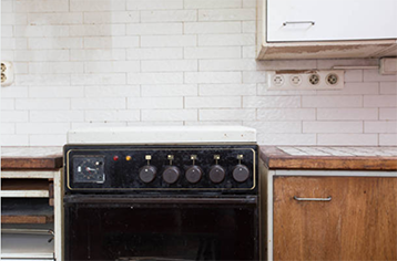 Old appliances in a kitchen during renovation